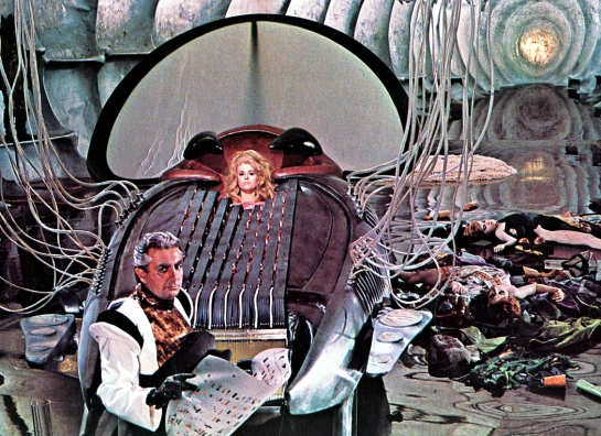 "Durand Durand (Milo O'Shea) tries to kill Barbarella in the ""Excessive Machine."""