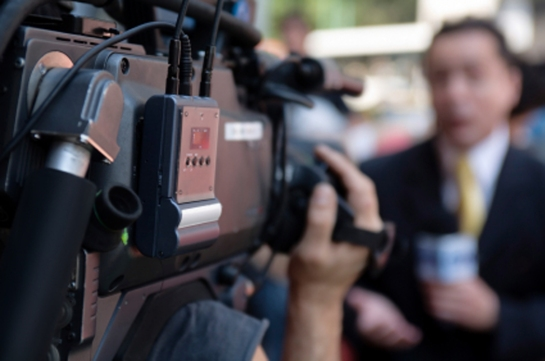 TV camera and reporter